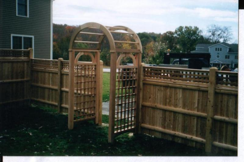 Wood Fence with Arbor